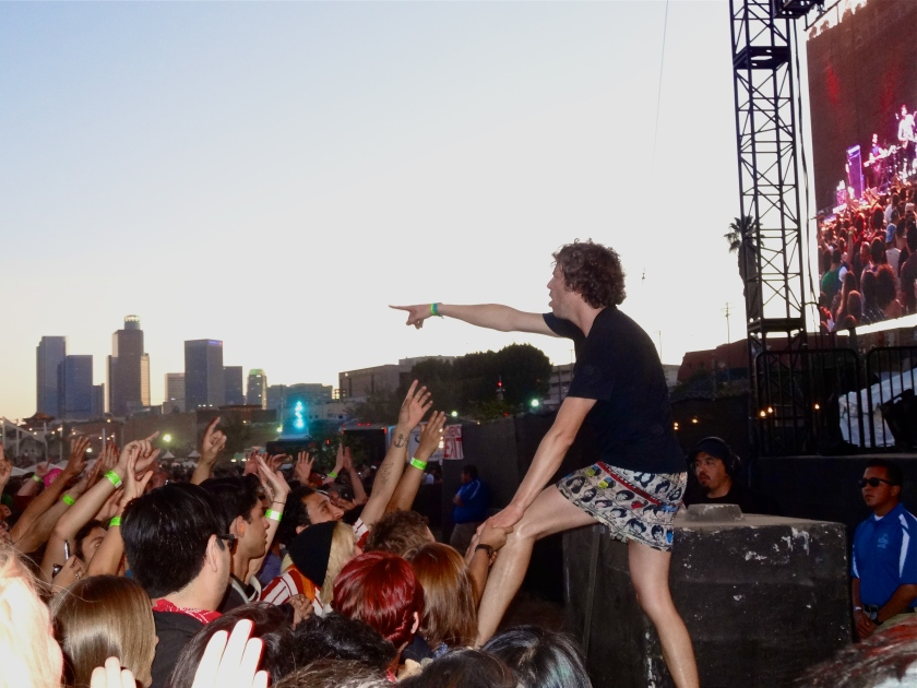 Nic Offer of !!! (ChkChkChk) getting into the audience during their set.