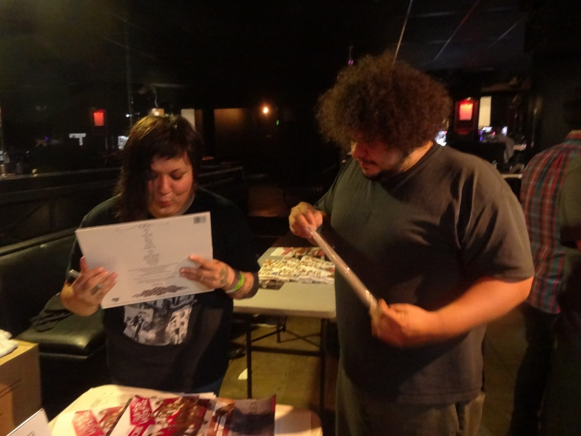 Phanie Diaz of Girl In A Coma autographing a fan's LP (FYI, this fan used to drum for the Beastie Boys back in the day) after their at the Echoplex 9/12/13