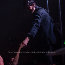 Jordan Cook of Reignwolf reaching out to a fan